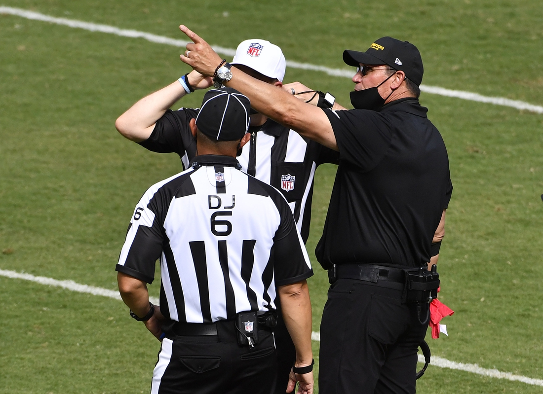 Sep 13, 2020; Landover, Maryland, USA; Washington Football Team head coach Ron Rivera discusses a call with the referee against the Philadelphia Eagles during the second half quarter at FedExField. Mandatory Credit: Brad Mills-USA TODAY Sports