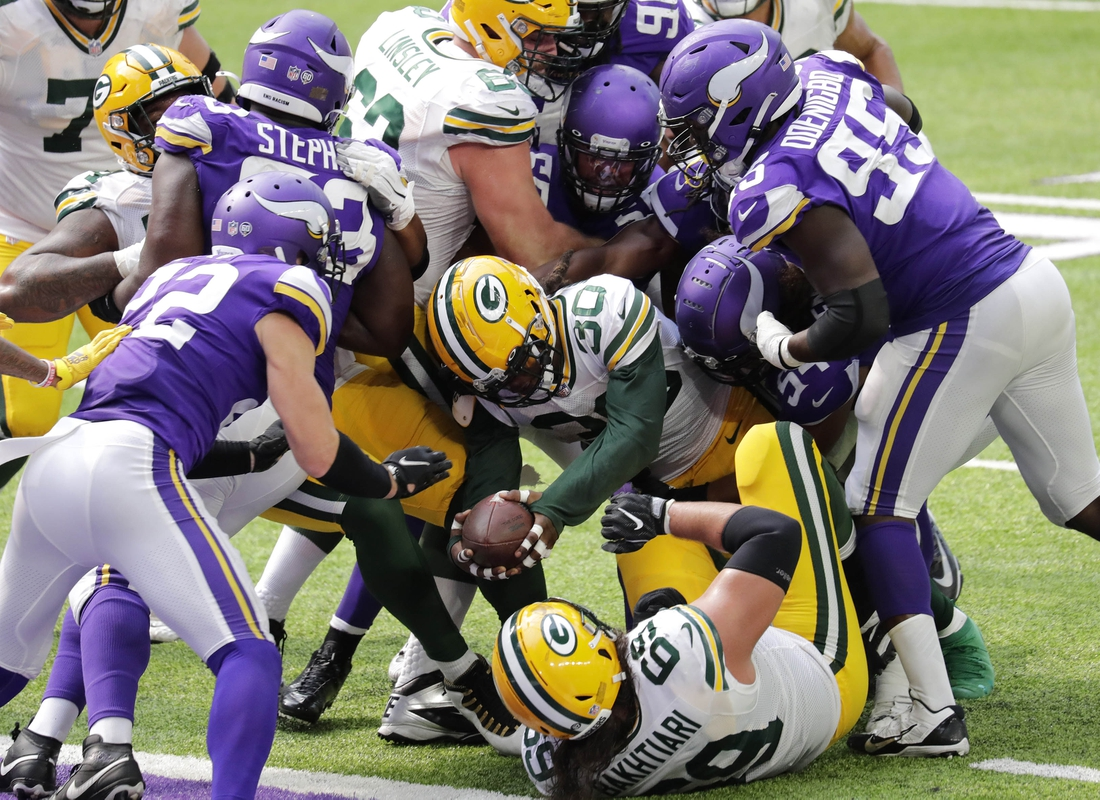 Sep 13, 2020; Minneapolis, MN, USA;  Green Bay Packers running back Jamaal Williams (30) is just short of the goal line on a third quarter run against the Minnesota Vikings during their football game Sunday, September 13, 2020, at U.S. Bank Stadium in Minneapolis, Minn. Mandatory Credit: Dan Powers/Appleton Post-Crescsent-USA TODAY NETWORK