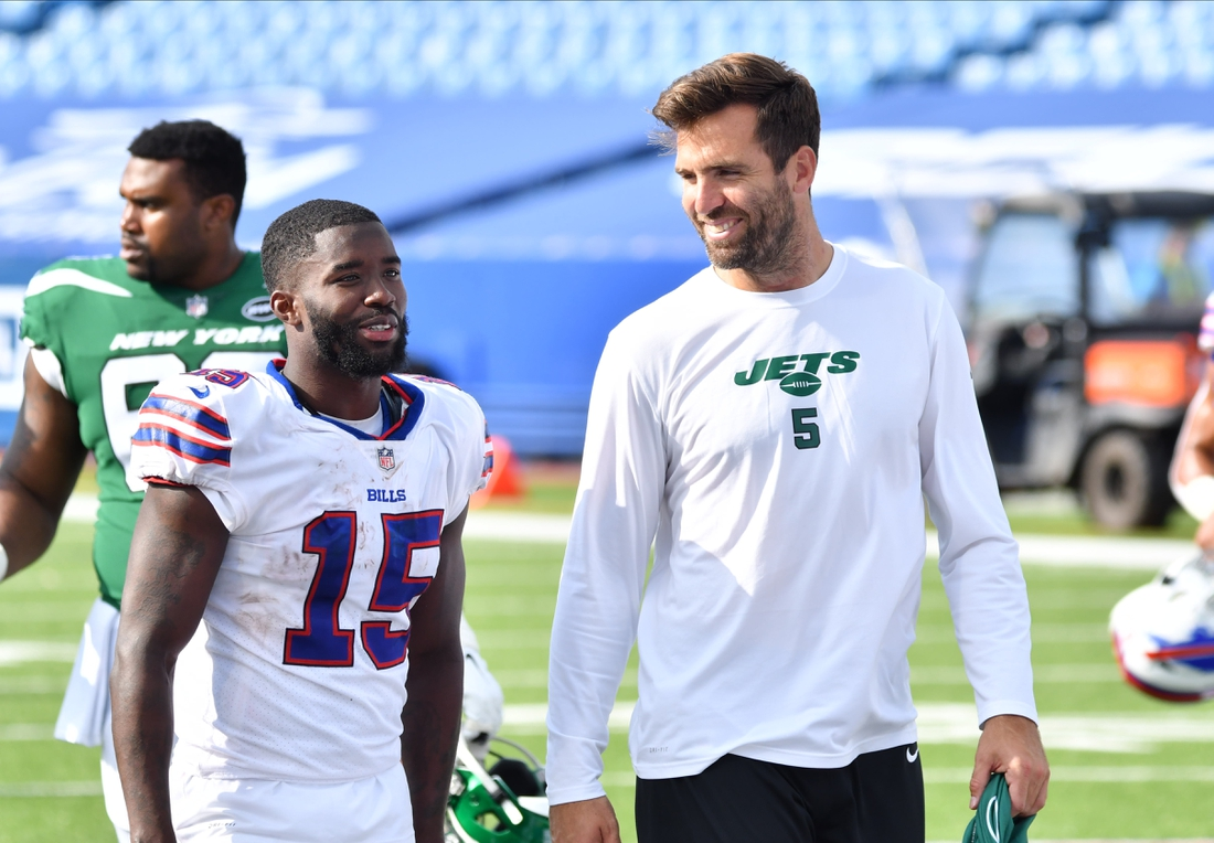 Sep 13, 2020; Orchard Park, New York, USA; Former teammates Buffalo Bills wide receiver John Brown (15) and New York Jets quarterback Joe Flacco (5) walk off the field together after a game at Bills Stadium. Mandatory Credit: Mark Konezny-USA TODAY Sports