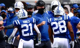 Sep 13, 2020; Jacksonville, Florida, USA; Indianapolis Colts head coach Frank Reich (black hat) congratulates running back Nyheim Hines (21) after scoring a touchdown during the first quarter against the Jacksonville Jaguars at TIAA Bank Field. Mandatory Credit: Douglas DeFelice-USA TODAY Sports