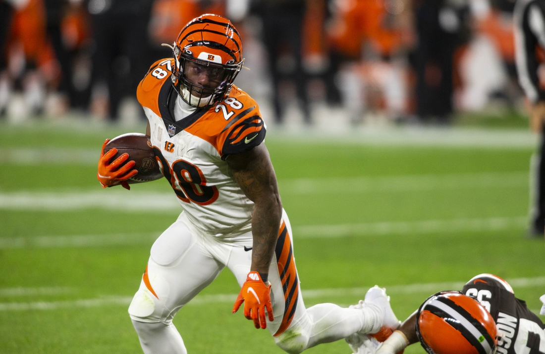 Sep 17, 2020; Cleveland, Ohio, USA; Cincinnati Bengals running back Joe Mixon (28) runs the ball against the Cleveland Browns during the third quarter at FirstEnergy Stadium. Mandatory Credit: Scott Galvin-USA TODAY Sports