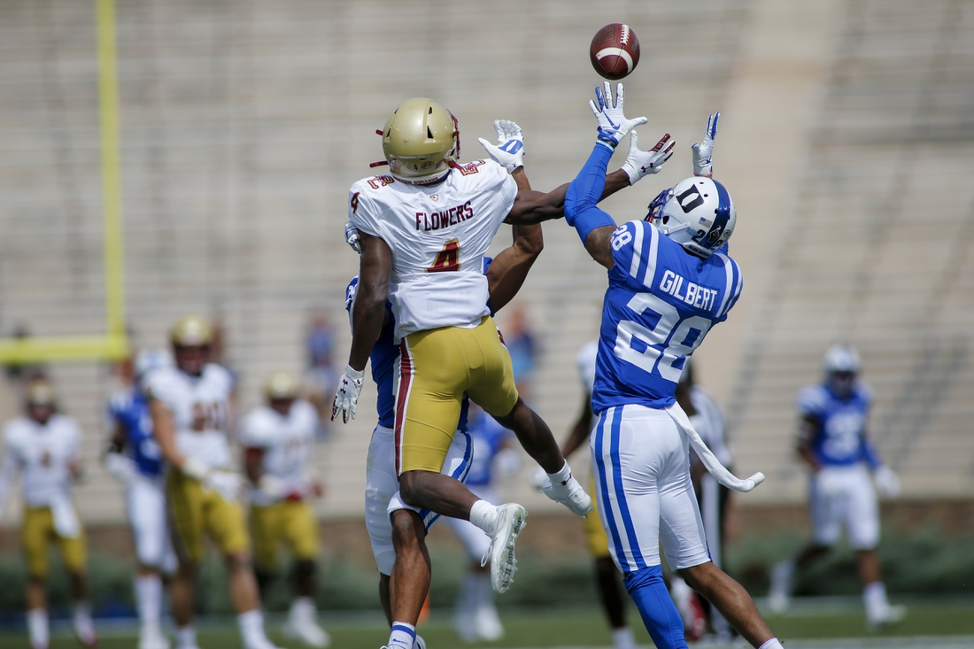 Sep 19, 2020; Durham, North Carolina, USA;  Duke Blue Devils cornerback Mark Gilbert (28) intercepts a pass intended for Boston College Eagles wide receiver Zay Flowers (4) in the first half at Wallace Wade Stadium. Mandatory Credit: Nell Redmond-USA TODAY Sports