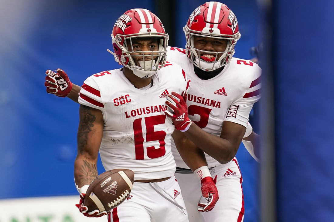 Sep 19, 2020; Atlanta, Georgia, USA; Louisiana-Lafayette Ragin Cajuns running back Elijah Mitchell (15) reacts with wide receiver Kyren Lacy (2) after he scored game winning touchdown against the Georgia State Panthers during overtime at Center parc Stadium. Mandatory Credit: Dale Zanine-USA TODAY Sports