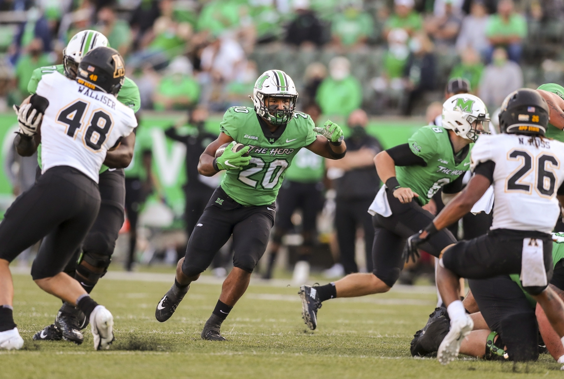 Sep 19, 2020; Huntington, West Virginia, USA; Marshall Thundering Herd running back Brenden Knox (20) runs the ball during the fourth quarter against the Appalachian State Mountaineers at Joan C. Edwards Stadium. Mandatory Credit: Ben Queen-USA TODAY Sports