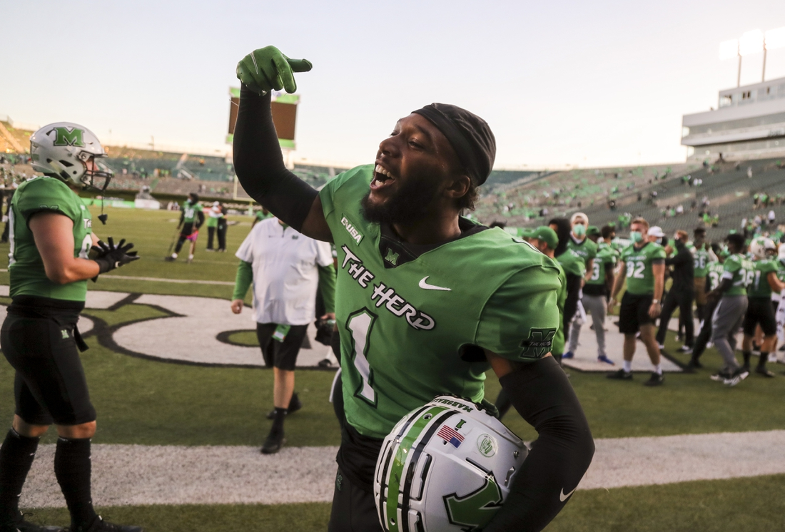 Sep 19, 2020; Huntington, West Virginia, USA; Marshall Thundering Herd safety Derrek Pitts (1) celebrates with teammates after defeating the Appalachian State Mountaineers at Joan C. Edwards Stadium. Mandatory Credit: Ben Queen-USA TODAY Sports