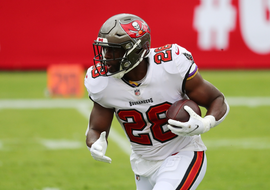 Sep 20, 2020; Tampa, Florida, USA;  Tampa Bay Buccaneers running back Leonard Fournette (28) runs the ball against the Carolina Panthers during the second quarter at Raymond James Stadium. Mandatory Credit: Kim Klement-USA TODAY Sports