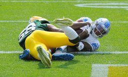 Sep 20, 2020; Green Bay, Wisconsin, USA;  Detroit Lions wide receiver Marvin Jones (11) catches a touchdown pass while being defended by Green Bay Packers outside linebacker Christian Kirksey (58) in the first quarter at Lambeau Field. Mandatory Credit: Michael McLoone-USA TODAY Sports