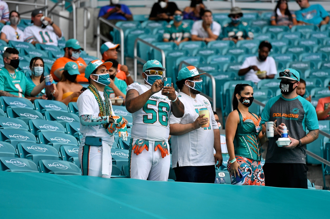 Sep 20, 2020; Miami Gardens, Florida, USA; Miami Dolphins fans in the stands during the first half between the Miami Dolphins and the Buffalo Bills at Hard Rock Stadium. Mandatory Credit: Jasen Vinlove-USA TODAY Sports
