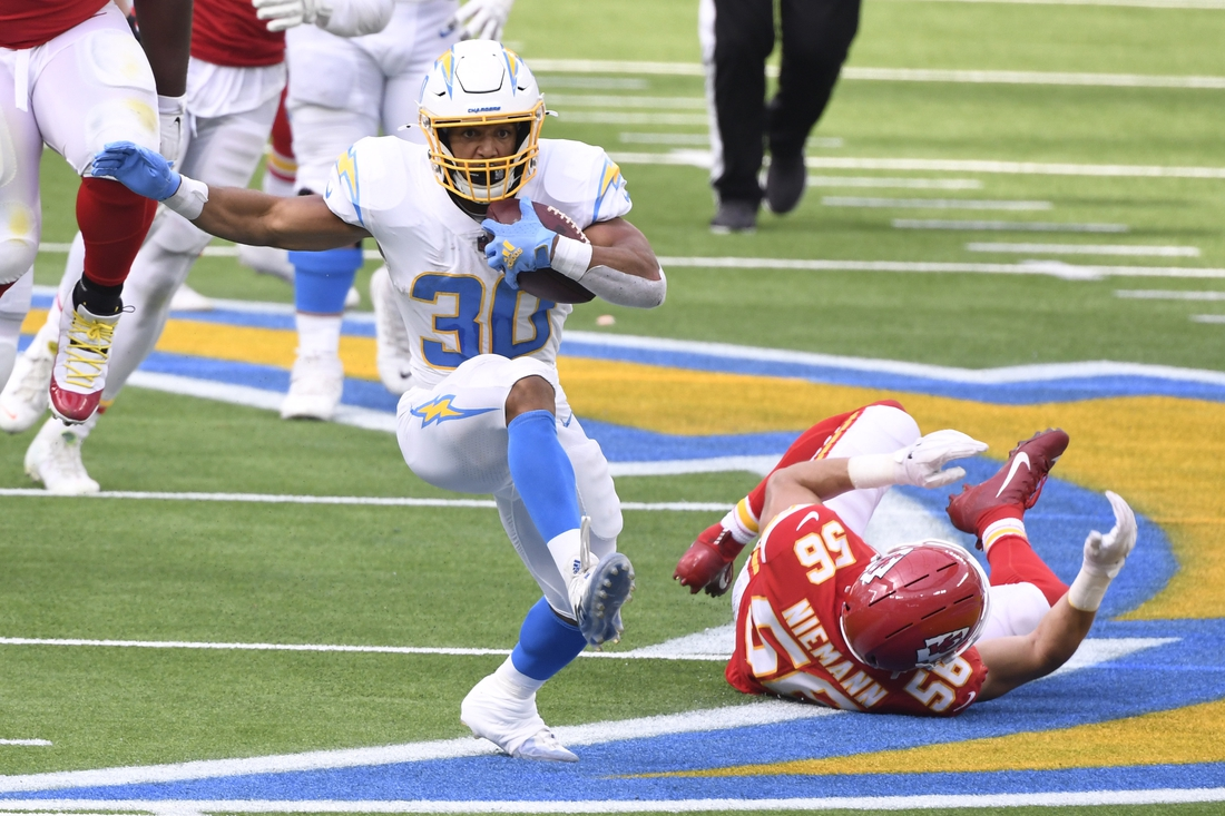 Sep 20, 2020; Inglewood, California, USA;  Los Angeles Chargers running back Austin Ekeler (30) breaks away from Kansas City Chiefs linebacker Ben Niemann (56) during the second quarter at SoFi Stadium. Mandatory Credit: Robert Hanashiro-USA TODAY Sports