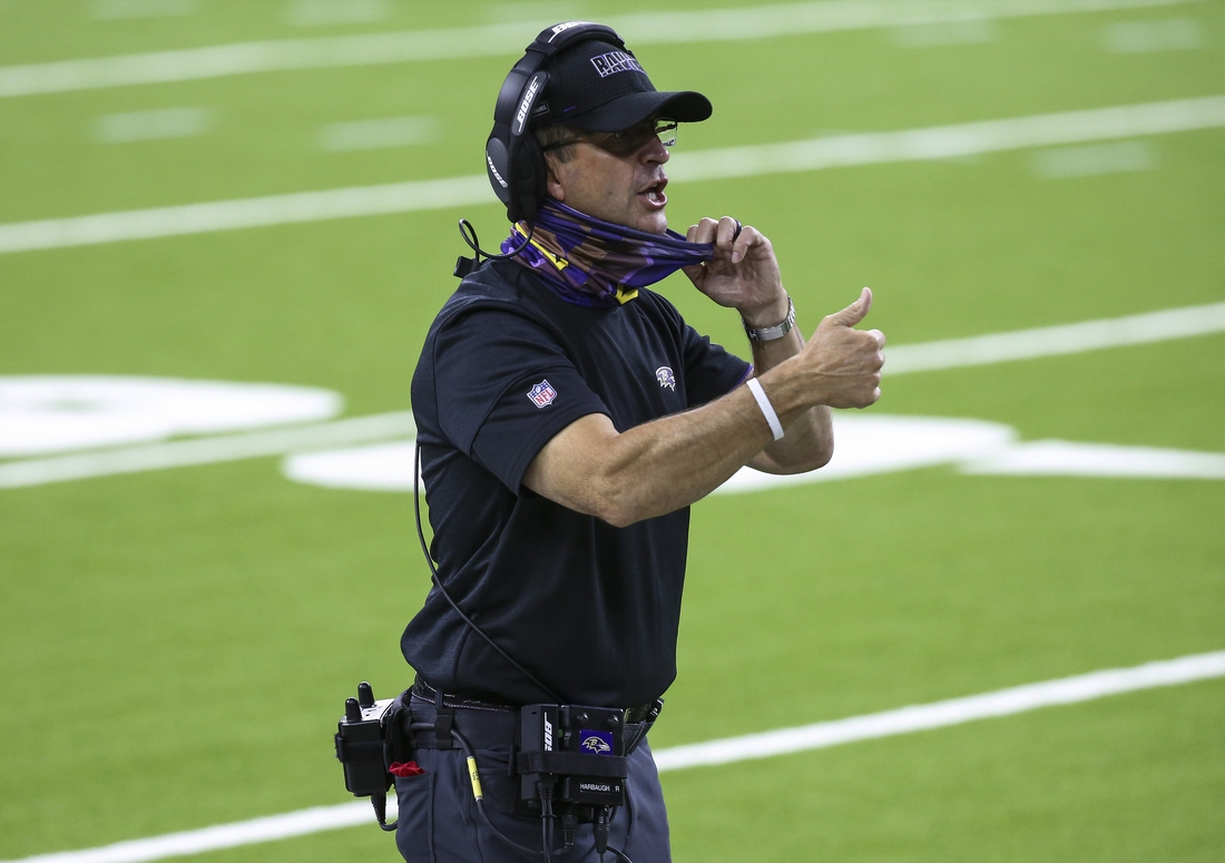 Sep 20, 2020; Houston, Texas, USA; Baltimore Ravens head coach John Harbaugh talks to an official during the second quarter against the Houston Texans at NRG Stadium. Mandatory Credit: Troy Taormina-USA TODAY Sports