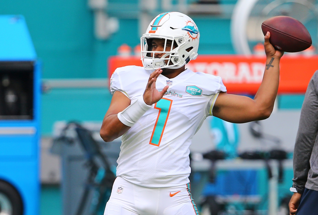Sep 20, 2020; Miami Gardens, Florida, USA; Miami Dolphins quarterback Tua Tagovailoa (1) warms up prior to the game against the Buffalo Bills at Hard Rock Stadium. Mandatory Credit: Jasen Vinlove-USA TODAY Sports