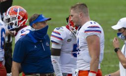 Sep 26, 2020; Oxford, Mississippi, USA; Florida Gators head coach Dan Mullen and Florida Gators quarterback Kyle Trask (11) during the first half against the Mississippi Rebels  at Vaught-Hemingway Stadium. Mandatory Credit: Justin Ford-USA TODAY Sports