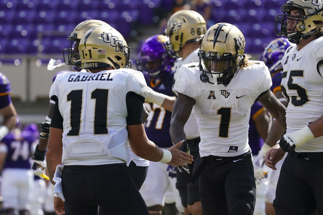 Sep 26, 2020; Greenville, North Carolina, USA;  UCF Knights wide receiver Jaylon Robinson (1) is congratulated by UCF Knights quarterback Dillon Gabriel (11) after his second half touchdown against the East Carolina Pirates at Dowdy-Ficklen Stadium. Mandatory Credit: James Guillory-USA TODAY Sports
