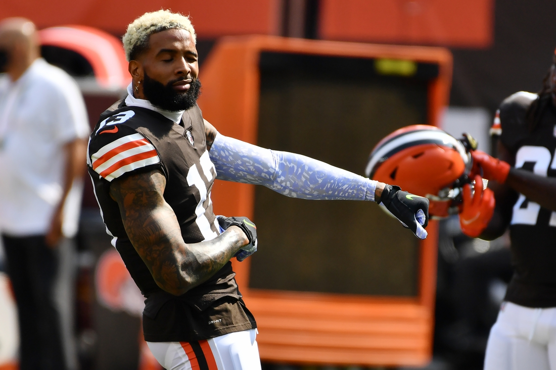 Sep 27, 2020; Cleveland, Ohio, USA; Cleveland Browns wide receiver Odell Beckham Jr. (13) dances while stretching before the game between the Cleveland Browns and the Washington Football Team at FirstEnergy Stadium. Mandatory Credit: Ken Blaze-USA TODAY Sports