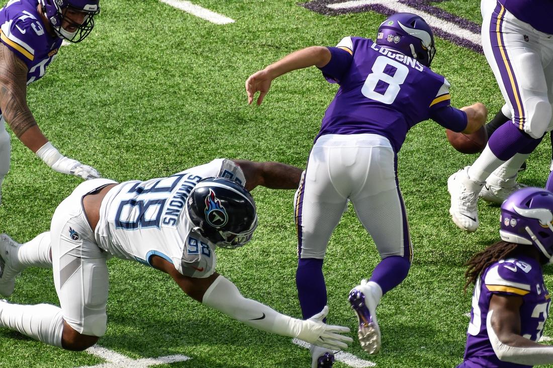 Sep 27, 2020; Minneapolis, Minnesota, USA; Tennessee Titans defensive tackle Jeffery Simmons (98) sacks Minnesota Vikings quarterback Kirk Cousins (8) during the first quarter at U.S. Bank Stadium. Mandatory Credit: Jeffrey Becker-USA TODAY Sports