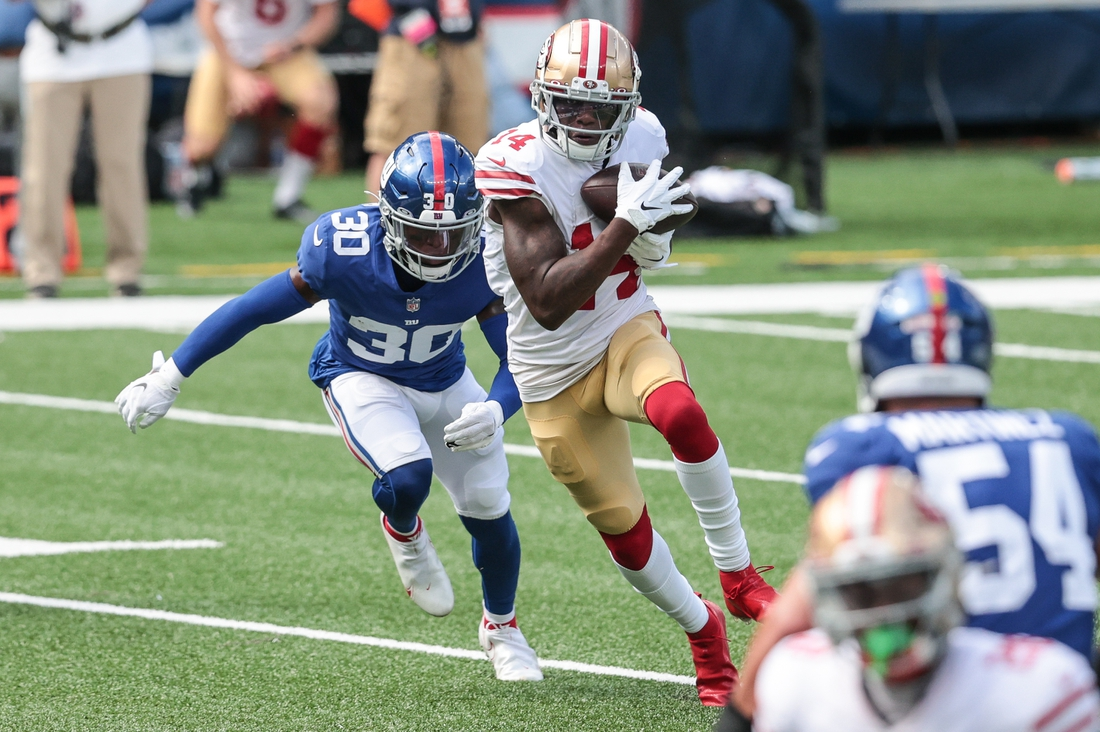 Sep 27, 2020; East Rutherford, New Jersey, USA; San Francisco 49ers wide receiver Mohamed Sanu (14) gains yards after catch as New York Giants cornerback Darnay Holmes (30) tackles during the first half at MetLife Stadium. Mandatory Credit: Vincent Carchietta-USA TODAY Sports