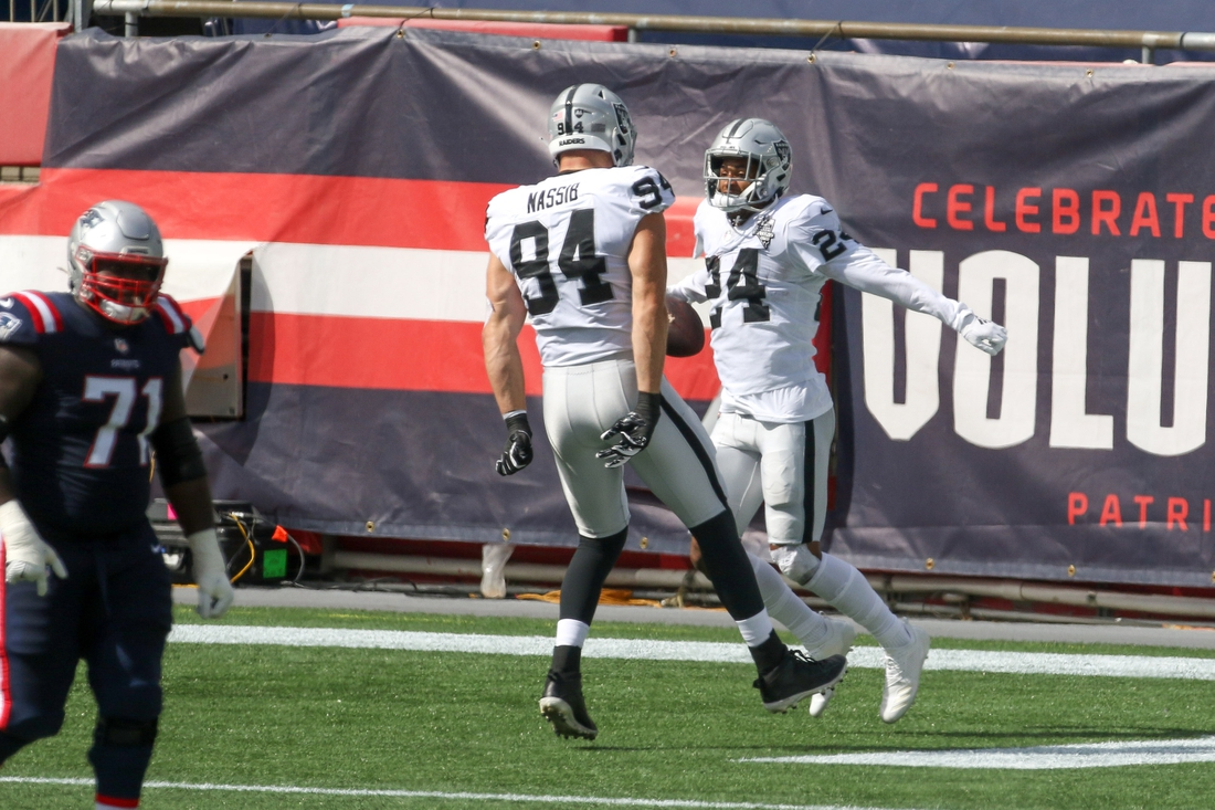 Sep 27, 2020; Foxborough, Massachusetts, USA; Las Vegas Raiders strong safety Johnathan Abram (24) celebrates with Las Vegas Raiders defensive end Carl Nassib (94) after intercepting New England Patriots quarterback Cam Newton (not pictured) during the first half at Gillette Stadium. Mandatory Credit: Paul Rutherford-USA TODAY Sports