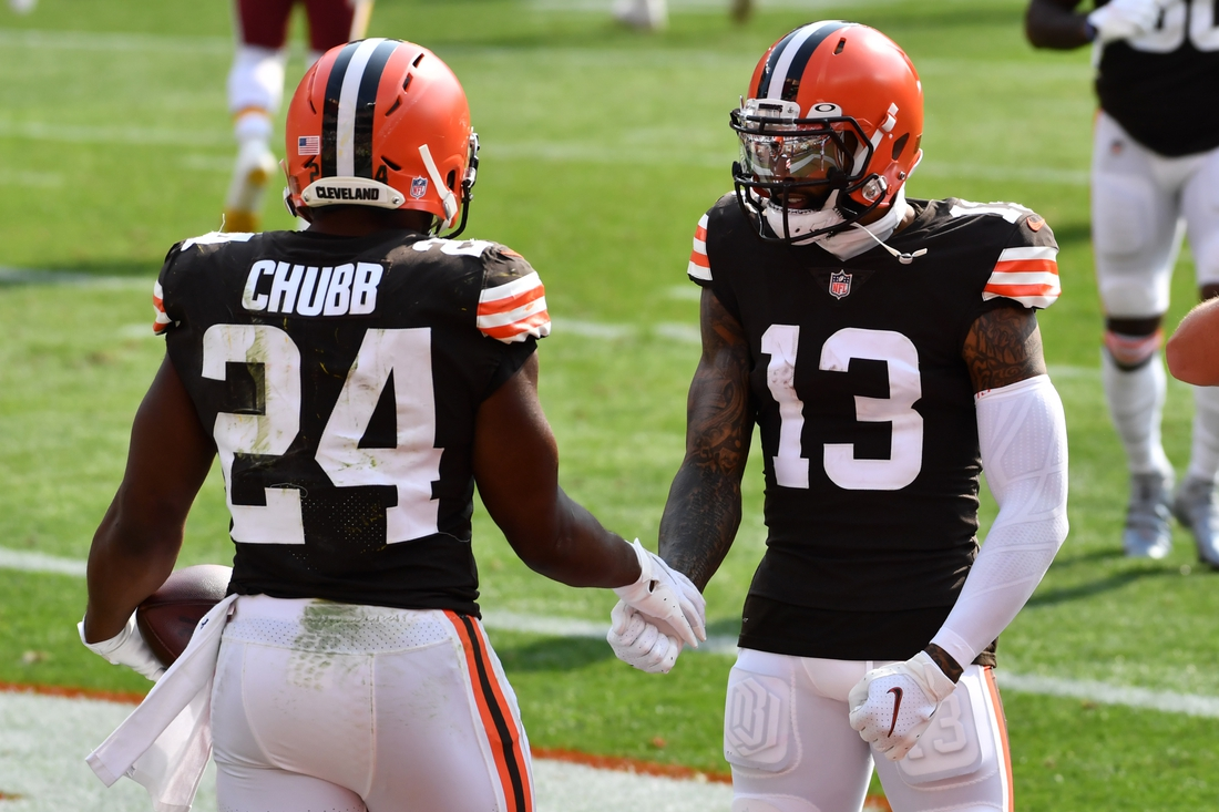 Sep 27, 2020; Cleveland, Ohio, USA; Cleveland Browns running back Nick Chubb (24) and wide receiver Odell Beckham Jr. (13) celebrate after Chubb scored a touchdown during the second half against the Washington Football Team at FirstEnergy Stadium. Mandatory Credit: Ken Blaze-USA TODAY Sports