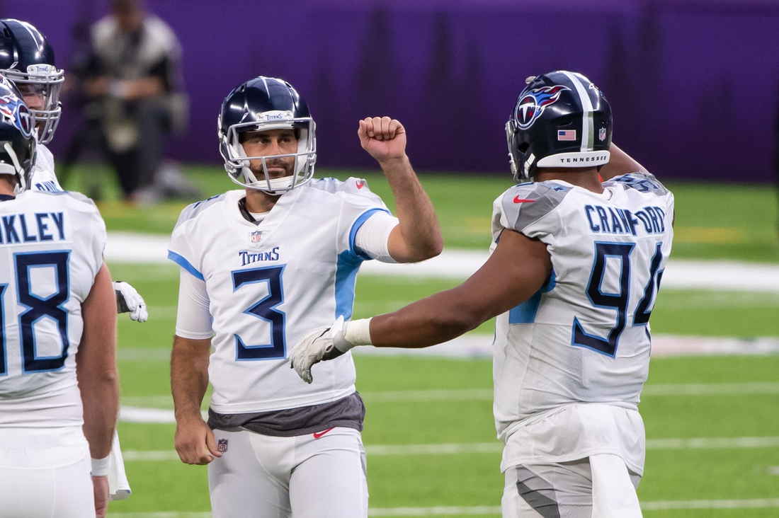 Sep 27, 2020; Minneapolis, Minnesota, USA; Tennessee Titans kicker Stephen Gostkowski (3) celebrates a field goal in the fourth quarter against the Minnesota Vikings at U.S. Bank Stadium. Mandatory Credit: Brad Rempel-USA TODAY Sports
