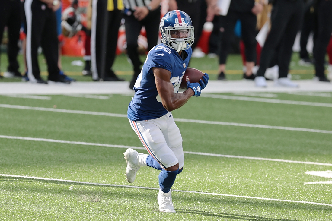 Sep 27, 2020; East Rutherford, New Jersey, USA; New York Giants wide receiver Darius Slayton (86) gains yards after catch during the second half against the San Francisco 49ers at MetLife Stadium. Mandatory Credit: Vincent Carchietta-USA TODAY Sports
