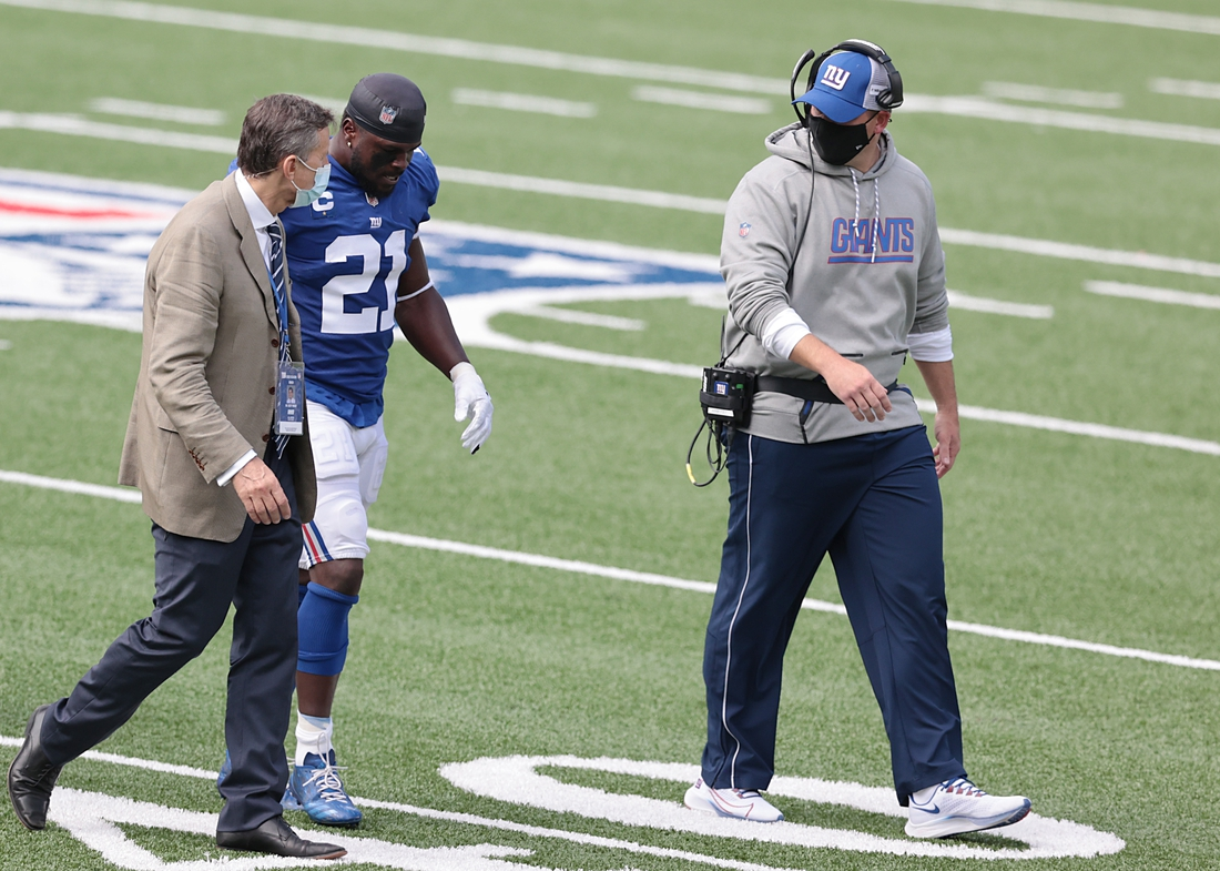 Sep 27, 2020; East Rutherford, New Jersey, USA; New York Giants strong safety Jabrill Peppers (21) after an injury walks off the field with head coach Joe Judge and a member of the medical staff during the first half against the San Francisco 49ers at MetLife Stadium. Mandatory Credit: Vincent Carchietta-USA TODAY Sports