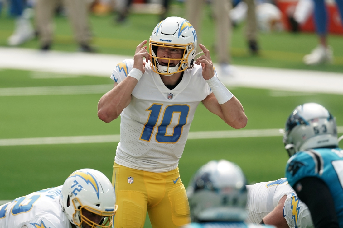 Sep 27, 2020; Inglewood, California, USA; Los Angeles Chargers quarterback Justin Herbert (10) prepares to take the snap in the second quarter against the Carolina Panthers  at SoFi Stadium. The Panthers defeated the Chargers 21-16. Mandatory Credit: Kirby Lee-USA TODAY Sports