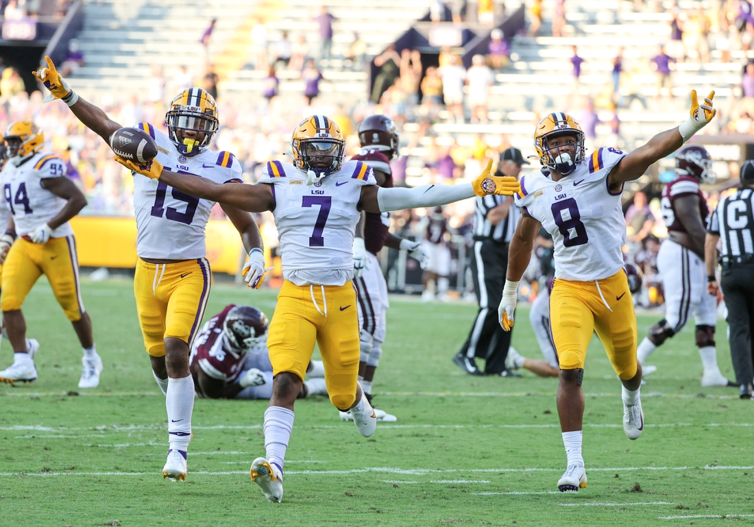 Sep 26, 2020; Baton Rouge, Louisiana, USA; LSU Tigers safety JaCoby Stevens (7) celebrates with linebacker Jabril Cox (19) and linebacker BJ Ojulari (8) after a turnover against the Mississippi State Bulldogs during the second half at Tiger Stadium. Mandatory Credit: Derick E. Hingle-USA TODAY Sports