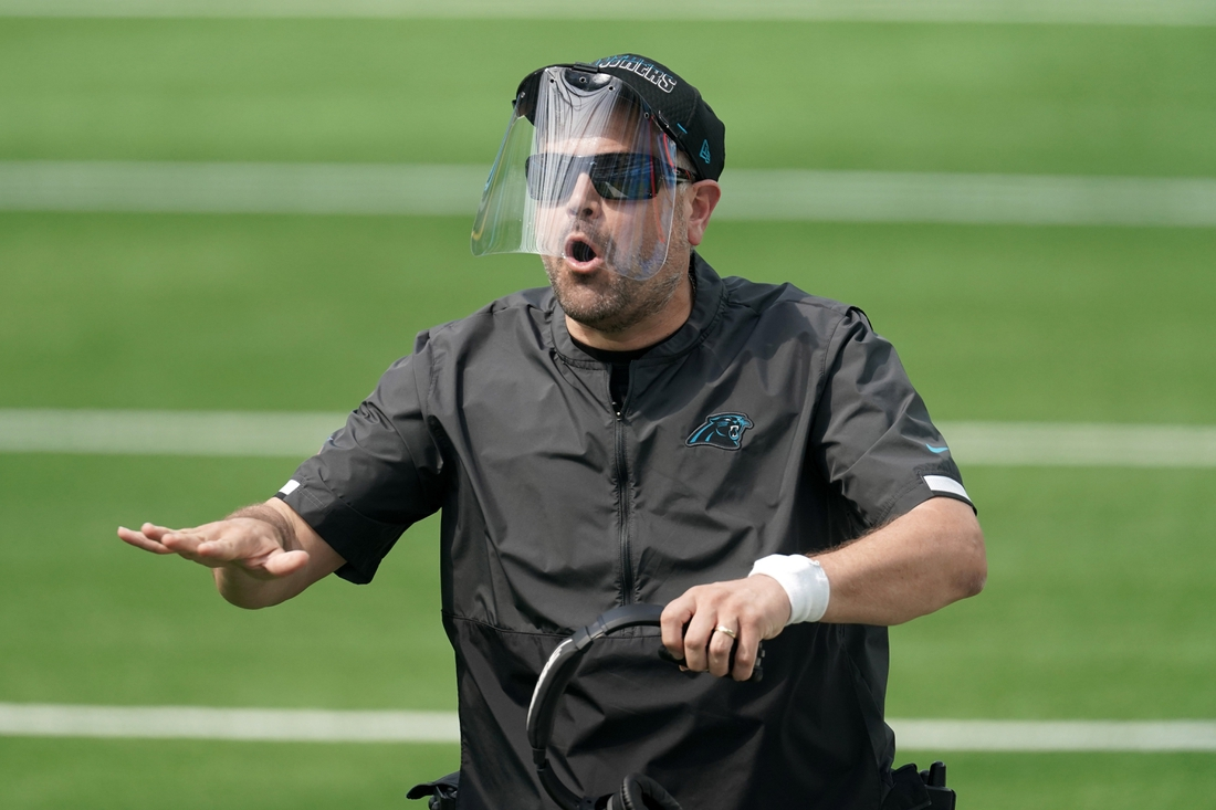 Sep 27, 2020; Inglewood, California, USA; Carolina Panthers head coach Matt Rhule wears a face shield in the first quarter against the Los Angeles Chargers  at SoFi Stadium. Mandatory Credit: Kirby Lee-USA TODAY Sports