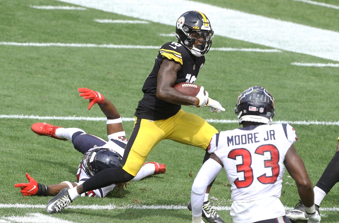 Sep 27, 2020; Pittsburgh, Pennsylvania, USA;  Pittsburgh Steelers wide receiver Diontae Johnson (18) runs after a catch against Houston Texans strong safety Justin Reid (20) and safety A.J. Moore (33) during the second quarter at Heinz Field. The Steelers won 28-21. Mandatory Credit: Charles LeClaire-USA TODAY Sports