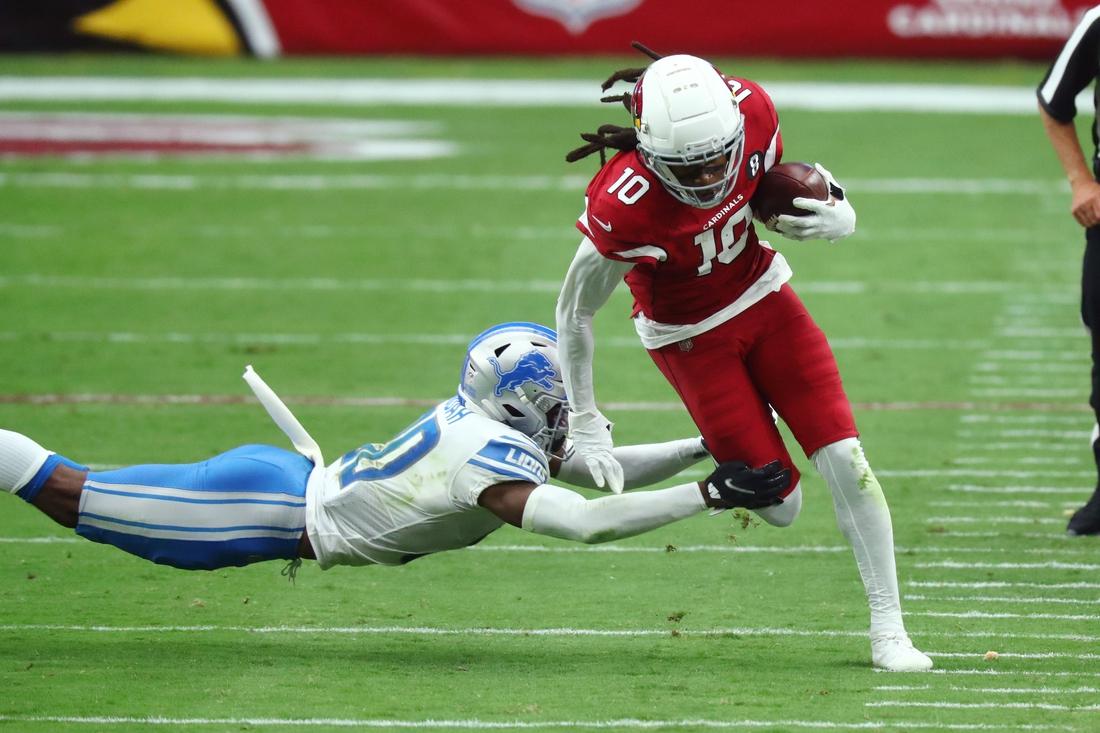 Sep 27, 2020; Glendale, Arizona, USA; Arizona Cardinals wide receiver Deandre Hopkins (10) avoids a tackle against Detroit Lions cornerback Jeff Okudah (30) in the third quarter at State Farm Stadium. Mandatory Credit: Billy Hardiman-USA TODAY Sports