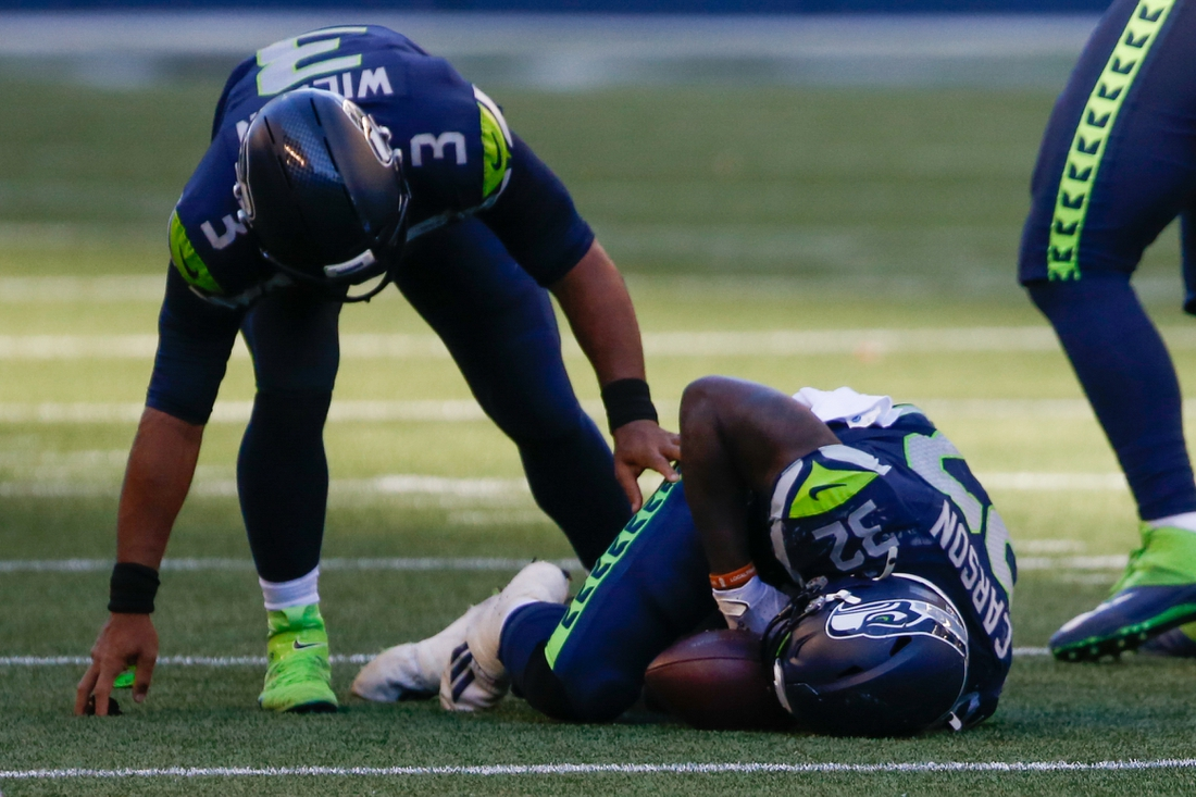 Sep 27, 2020; Seattle, Washington, USA; Seattle Seahawks quarterback Russell Wilson (3) reacts to an injury suffered by running back Chris Carson (32) during the fourth quarter against the Dallas Cowboys at CenturyLink Field. Carson was injured on the play. Mandatory Credit: Joe Nicholson-USA TODAY Sports