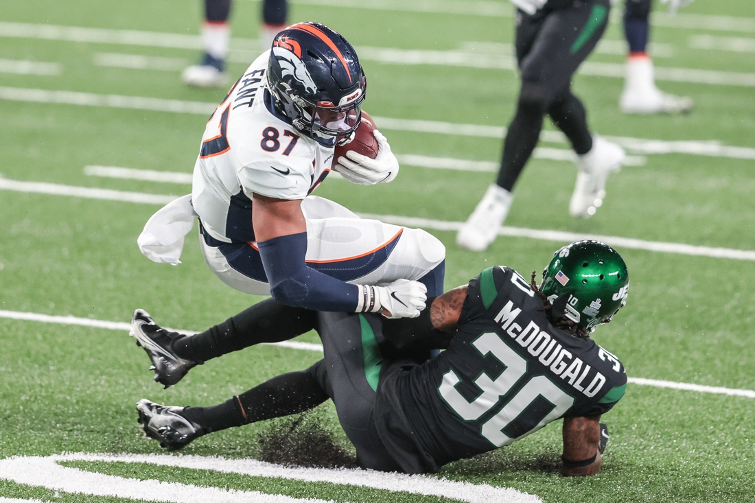 Oct 1, 2020; East Rutherford, New Jersey, USA; Denver Broncos tight end Noah Fant (87) is tackled by New York Jets strong safety Bradley McDougald (30) during the second half at MetLife Stadium. Mandatory Credit: Vincent Carchietta-USA TODAY Sports