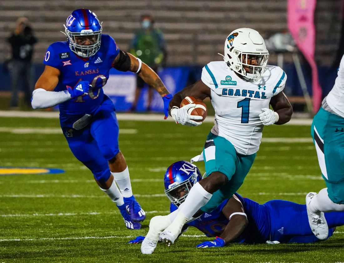Sep 12, 2020; Lawrence, Kansas, USA; Coastal Carolina Chanticleers running back CJ Marable (1) runs past Kansas Jayhawks linebacker Dru Prox (40) and  linebacker Denzel Feaster (18) at David Booth Kansas Memorial Stadium. Mandatory Credit: Jay Biggerstaff-USA TODAY Sports