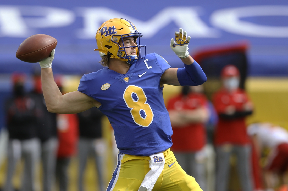 Oct 3, 2020; Pittsburgh, Pennsylvania, USA;  Pittsburgh Panthers quarterback Kenny Pickett (8) passes against the North Carolina State Wolfpack during the first quarter at Heinz Field. Mandatory Credit: Charles LeClaire-USA TODAY Sports