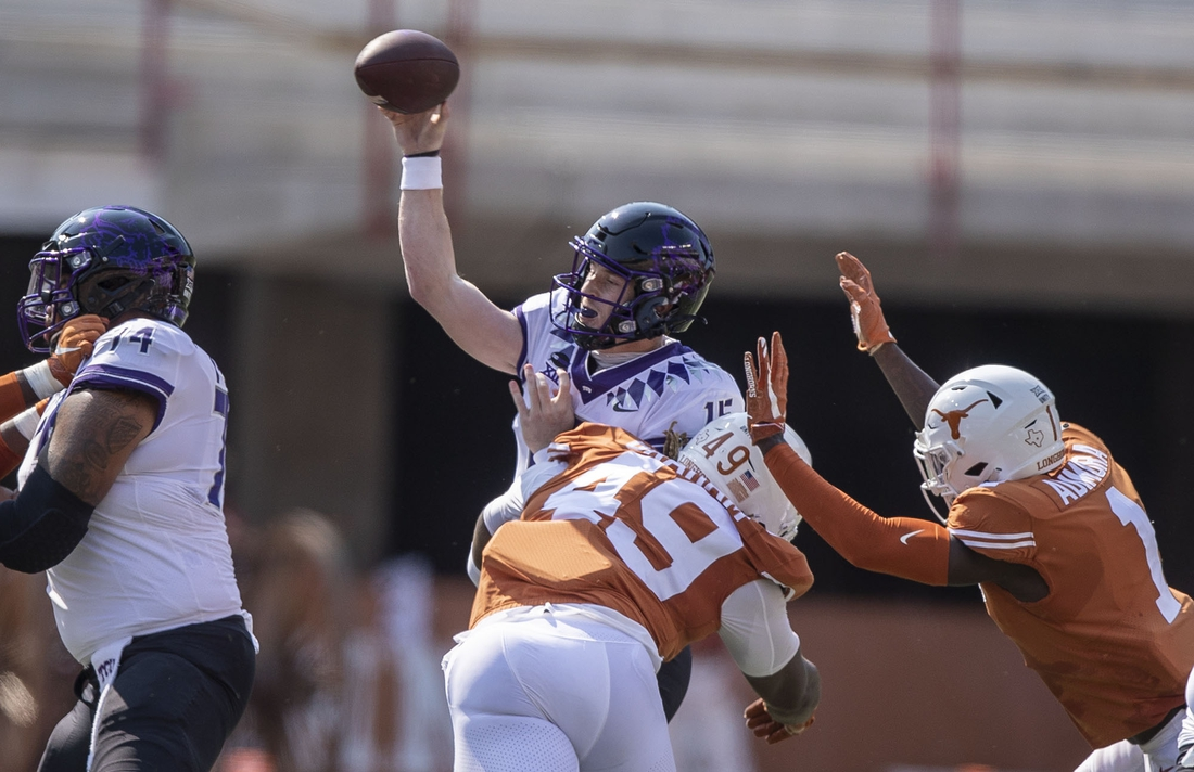 Oct 3, 2020; Austin, Texas, USA;   Texas Longhorns defensive lineman Ta'Quon Graham (49) hits TCU Horned Frogs quarterback Max Duggan (15) as he tries to pass the ball in the first quarter in a NCAA college football game at Darrell K Royal-Texas Memorial Stadium. Mandatory Credit: Ricardo B. Brazziell-USA TODAY Sports