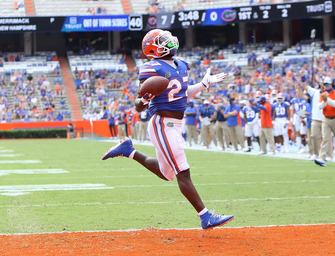 Oct 3, 2020; Gainesville, FL, USA;  Florida Gators running back Dameon Pierce (27) scores the Gators first touchdown of the game against South Carolina at Ben Hill Griffin Stadium, in Gainesville, Fla. Oct. 3, 2020.  Mandatory Credit: Brad McClenny-USA TODAY NETWORK