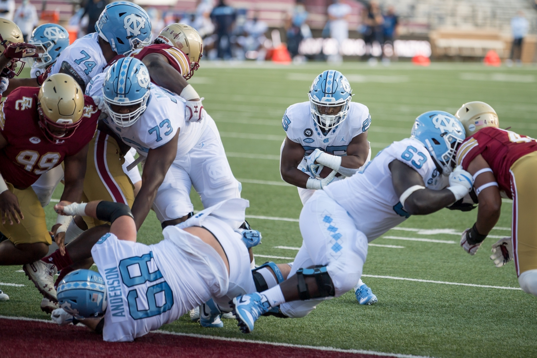 Oct 3, 2020; Chestnut Hill, Massachusetts, USA; North Carolina Tar Heels running back Javonte Williams (25) rushes for a touchdown during the first quarter against the Boston College Eagles at Alumni Stadium. Mandatory Credit: Adam Richins-USA TODAY Sports