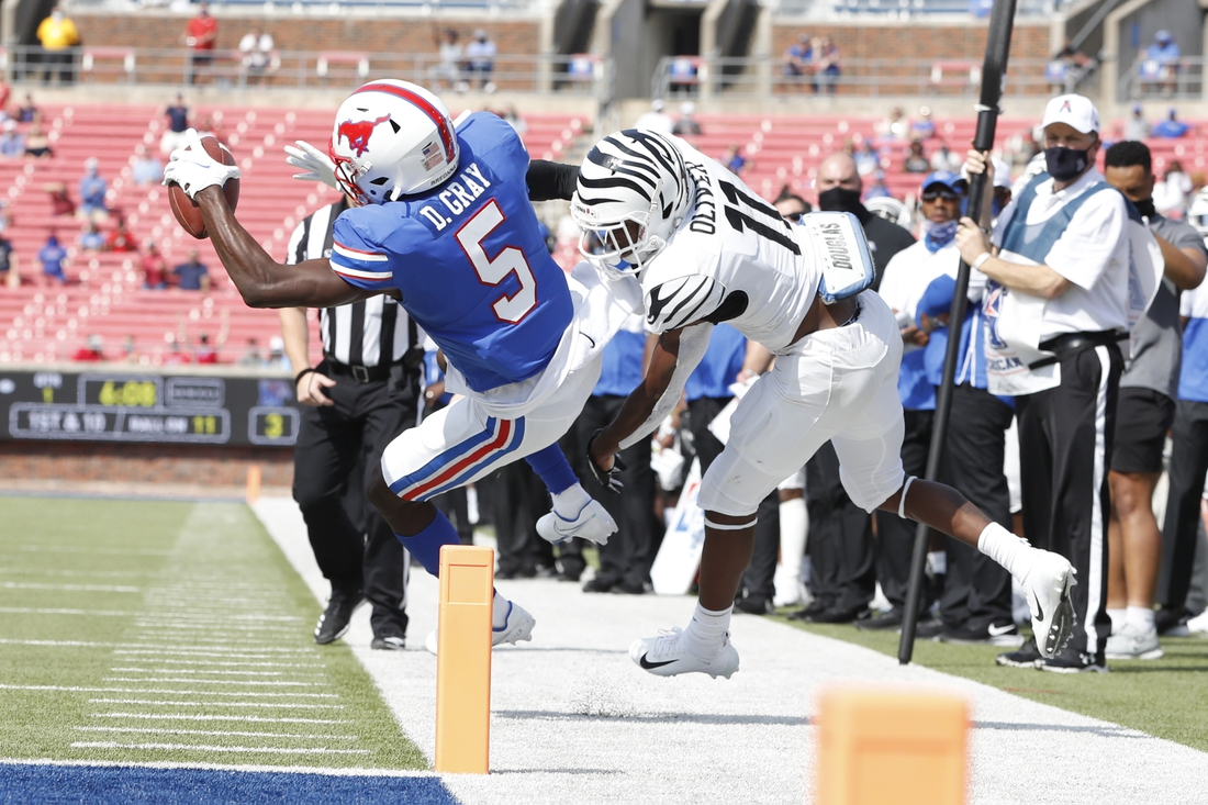Oct 3, 2020; Dallas, Texas, USA; Southern Methodist Mustangs wide receiver Danny Gray (5) is tackled by Memphis Tigers defensive back Sylvonta Oliver (11) in the first quarter at Gerald J. Ford Stadium. Mandatory Credit: Tim Heitman-USA TODAY Sports
