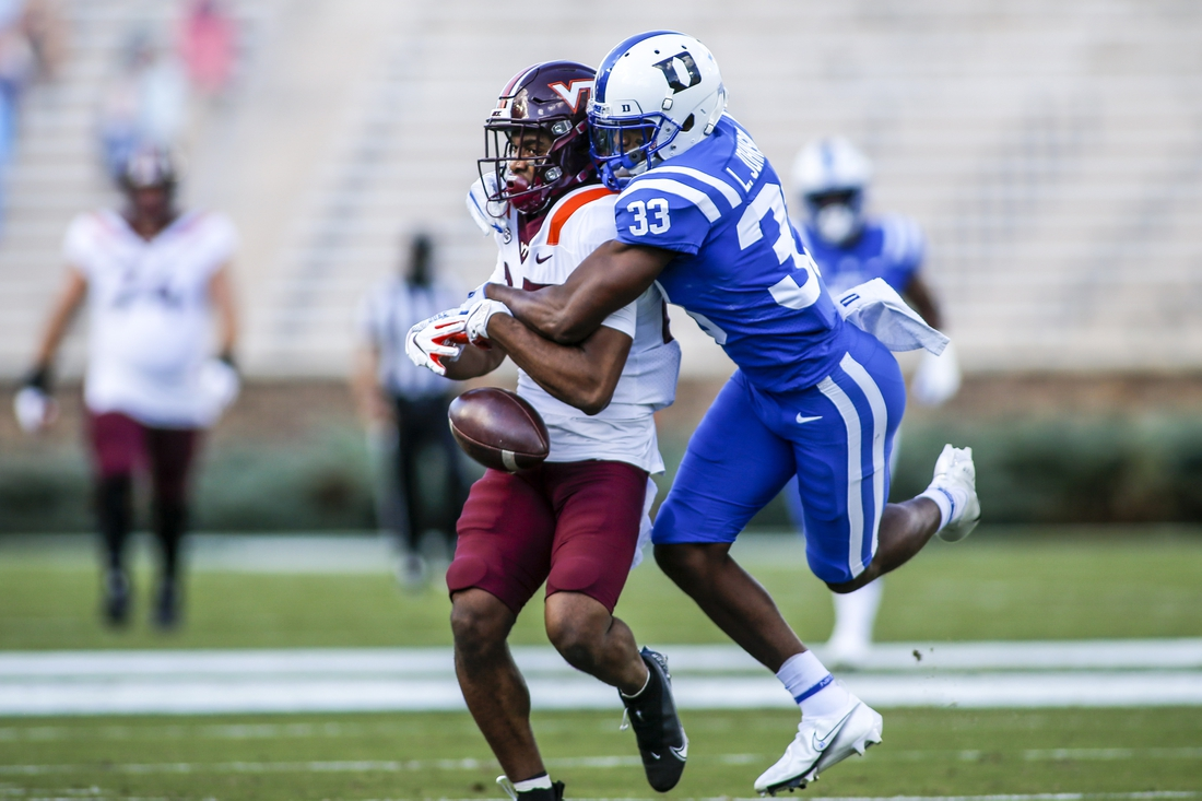 Oct 3, 2020; Durham, North Carolina, USA;  Duke Blue Devils cornerback Leonard Johnson (33) breaks up a pass intended for Virginia Tech Hokies wide receiver Tayvion Robinson (83)  in the first half at Wallace Wade Stadium. Mandatory Credit: Nell Redmond-USA TODAY Sports