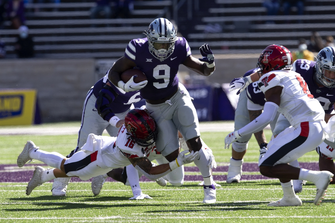 Oct 3, 2020; Manhattan, Kansas, USA; Kansas State Wildcats running back Jacardia Wright (9) is tackled by Texas Tech Red Raiders defensive back Thomas Leggett (16) during a game at Bill Snyder Family Football Stadium. Mandatory Credit: Scott Sewell-USA TODAY Sports