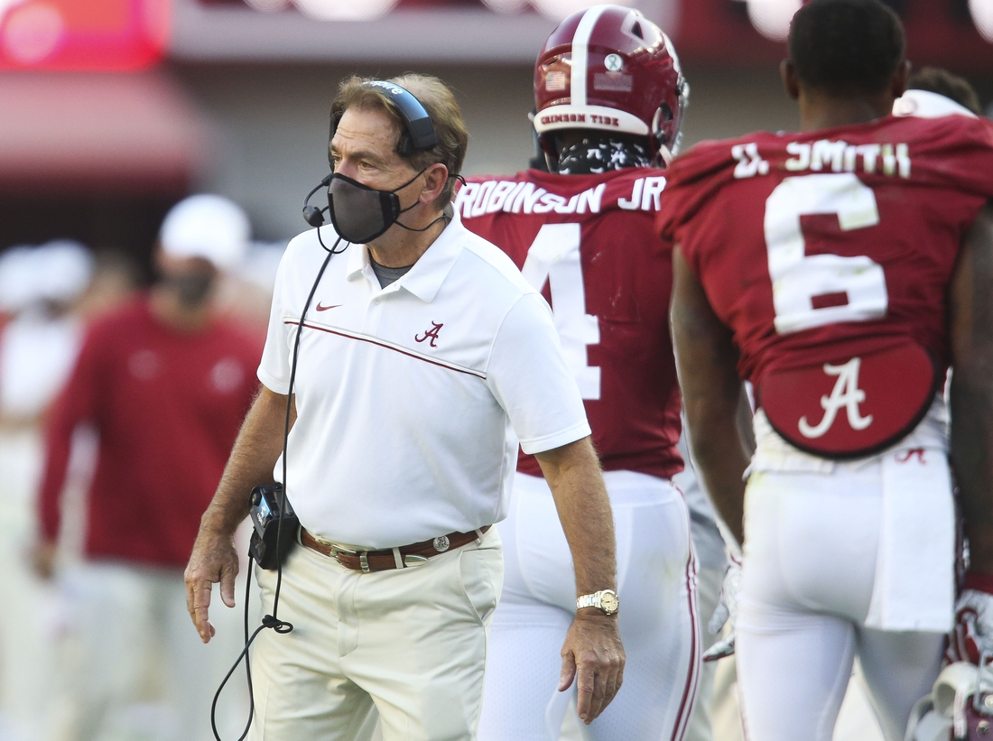 Oct 3, 2020; Tuscaloosa, Alabama, USA; Alabama Head Coach Nick Saban wears a mask on the sideline as he coaches his team at Bryant-Denny Stadium. Alabama defeated A&M 52-24. Mandatory Credit: Gary Cosby Jr/The Tuscaloosa News via USA TODAY Sports