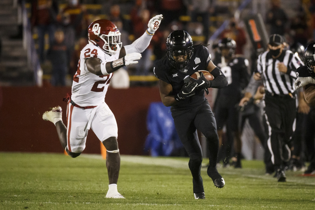 Oct 3, 2020; Ames, Iowa, USA; Oklahoma linebacker Brian Asamoah (24) tackles Iowa State wide receiver Tarique Milton (1) during their football game at Jack Trice Stadium. Oklahoma takes a 17-13 lead over ISU into halftime. Mandatory Credit: Brian Powers-USA TODAY Sports