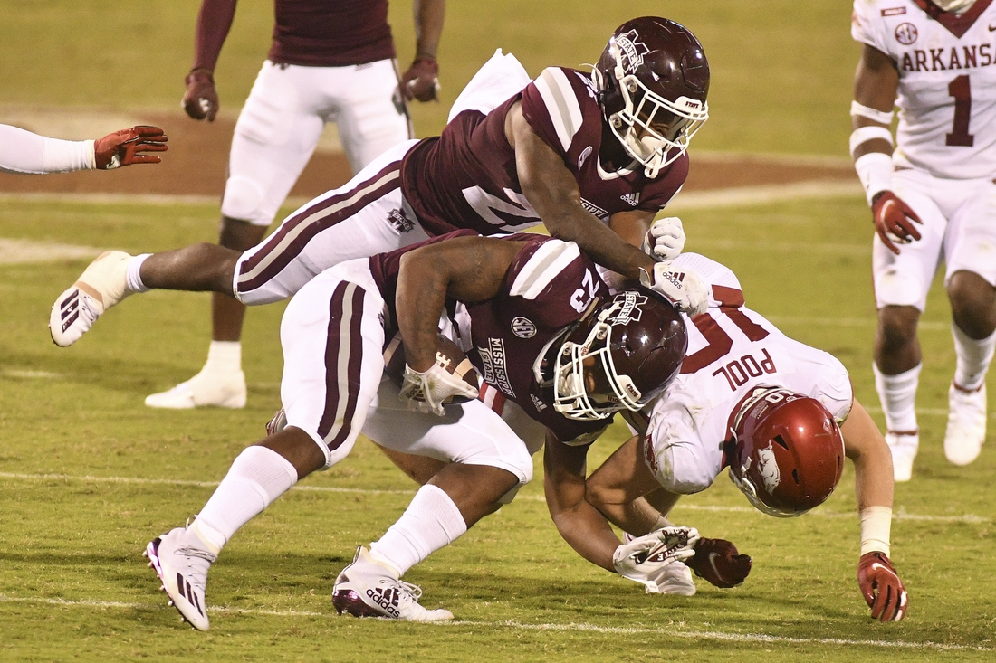 Oct 3, 2020; Starkville, Mississippi, USA; Mississippi State Bulldogs wide receiver Brad Cumbest (25) collides with running back Jo'quavious Marks (21) as he attempts to block Arkansas Razorbacks linebacker Bumper Pool (10) during the second quarter at Davis Wade Stadium at Scott Field. Mandatory Credit: Matt Bush-USA TODAY Sports