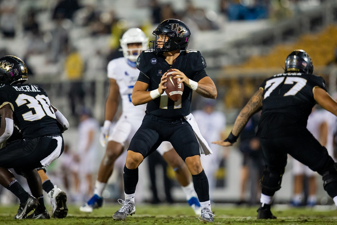 Oct 3, 2020; Orlando, Florida, USA; UCF Knights quarterback Dillon Gabriel (11) prepares to pass during the second quarter of a game against the Tulsa Golden Hurricane at Spectrum Stadium. Mandatory Credit: Mary Holt-USA TODAY Sports
