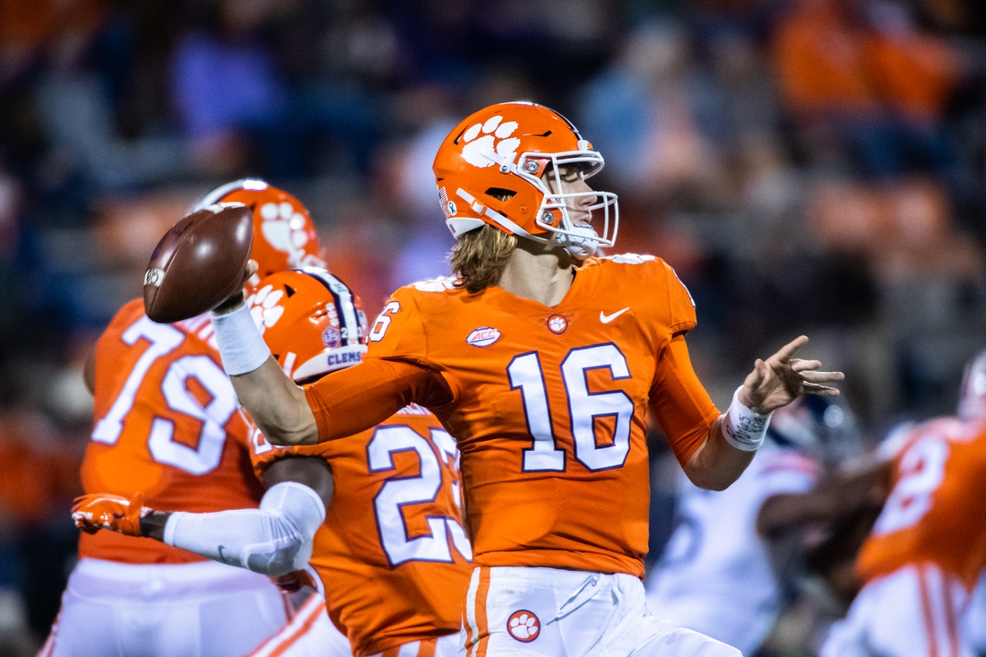 Oct 3, 2020; Clemson, South Carolina, USA; Clemson quarterback Trevor Lawrence (16) looks to make a pass during their game against Virginia at Memorial Stadium. Mandatory Credit: Ken Ruinard-USA TODAY Sports