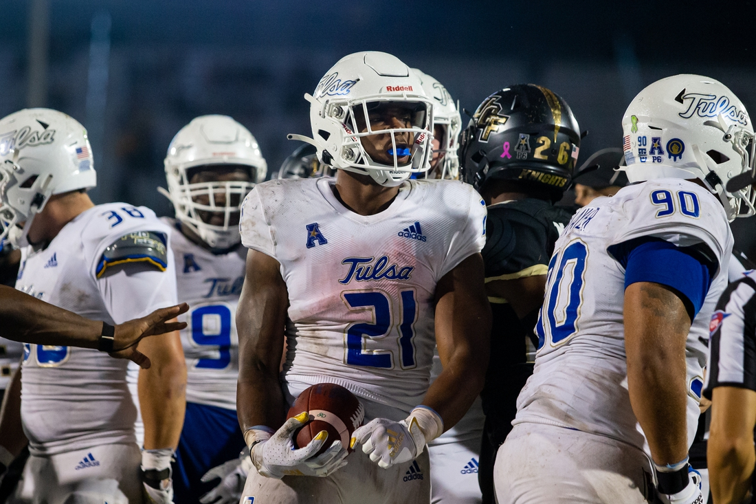 Oct 3, 2020; Orlando, Florida, USA; Tulsa Golden Hurricane running back T.K. Wilkerson (21) celebrates after scoring a touchdown during the third quarter of a game against the UCF Knights at Spectrum Stadium. Mandatory Credit: Mary Holt-USA TODAY Sports