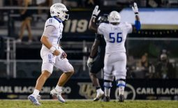 Oct 3, 2020; Orlando, Florida, USA; Tulsa Golden Hurricane quarterback Zach Smith (11) celebrates as offensive tackle Tyler Smith (56) signals a touchdown during the fourth quarter of a game against the UCF Knights at Spectrum Stadium. Mandatory Credit: Mary Holt-USA TODAY Sports