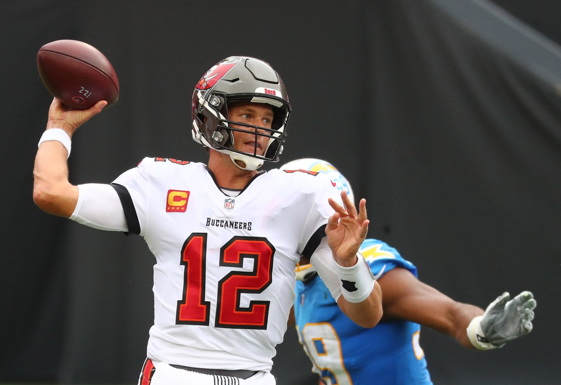 Oct 4, 2020; Tampa, Florida, USA; Tampa Bay Buccaneers quarterback Tom Brady (12) throws a pass against the Los Angeles Chargers in the first quarter of a NFL game at Raymond James Stadium. Mandatory Credit: Kim Klement-USA TODAY Sports