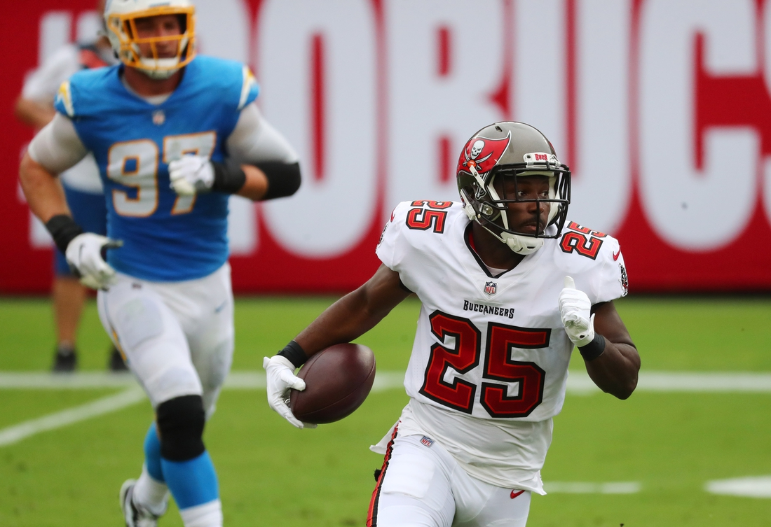 Oct 4, 2020; Tampa, Florida, USA;  Tampa Bay Buccaneers running back LeSean McCoy (25) runs the ball against the Los Angeles Chargers in the first quarter of a NFL game at Raymond James Stadium. Mandatory Credit: Kim Klement-USA TODAY Sports