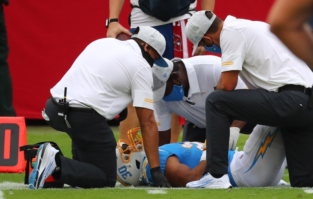 Oct 4, 2020; Tampa, Florida, USA; Los Angeles Chargers running back Austin Ekeler (30) is checked on after an apparent injury against the Tampa Bay Buccaneers in the first quarter of a NFL game at Raymond James Stadium. Mandatory Credit: Kim Klement-USA TODAY Sports